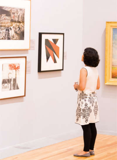 Student looking at art